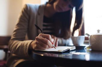 Lady writing in agenda